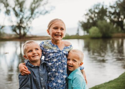 Portrait of three young kids hugging and smiling