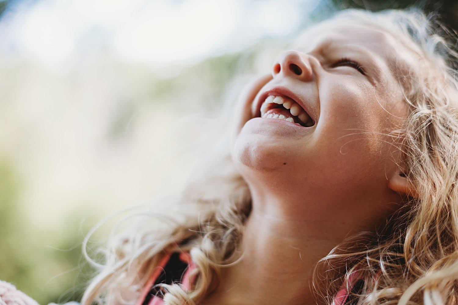 A young girl laughing
