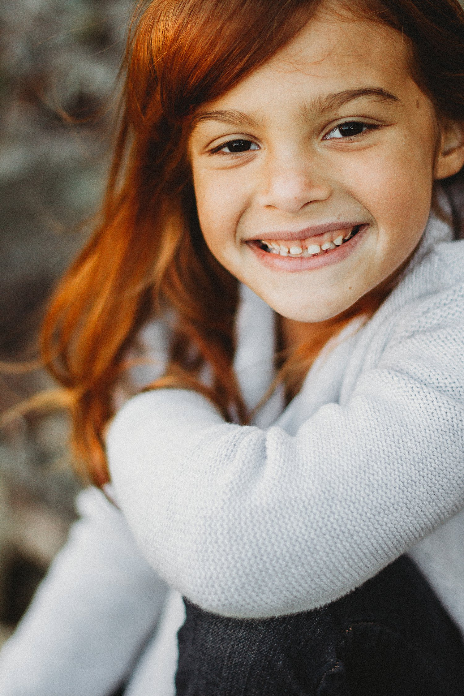 Portrait of young girl smiling with red hair