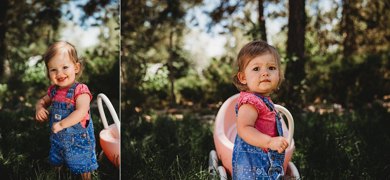 Toddler girl pushing toy stroller