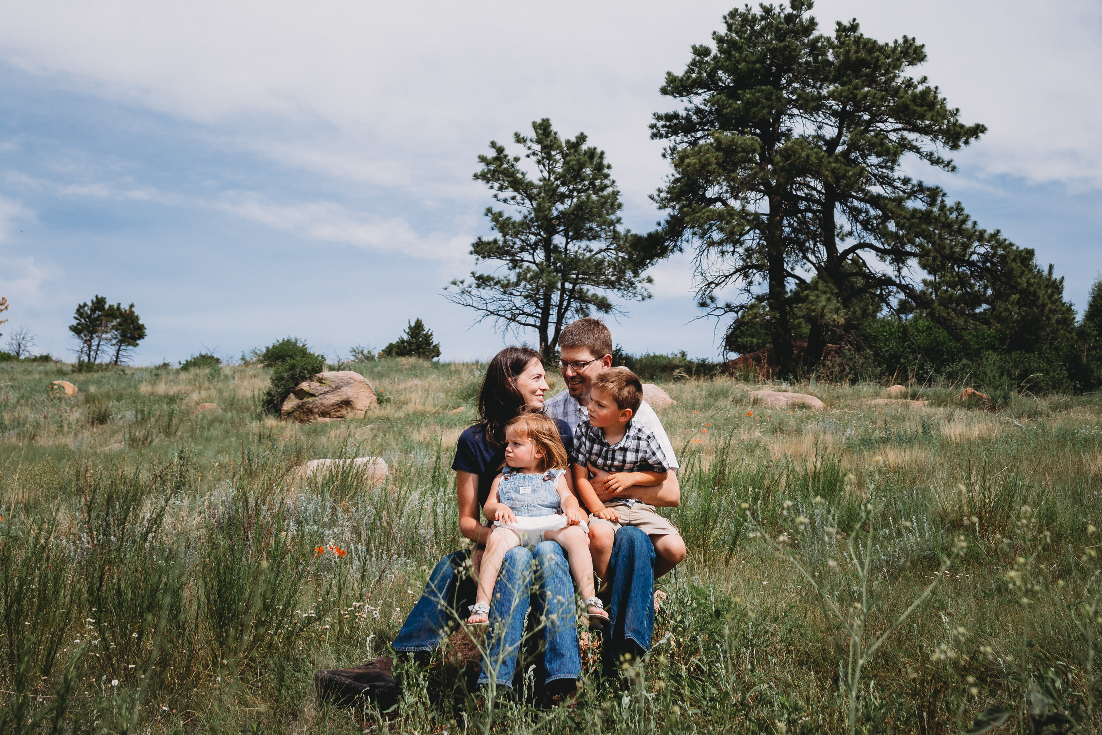 Family of four sitting in field at Stratton Open Space, Colorado Springs