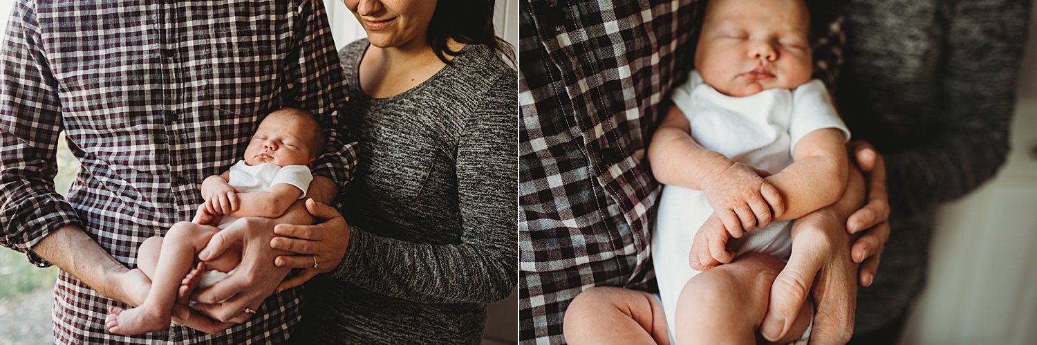Lifestyle family portraits of parents holding newborn baby