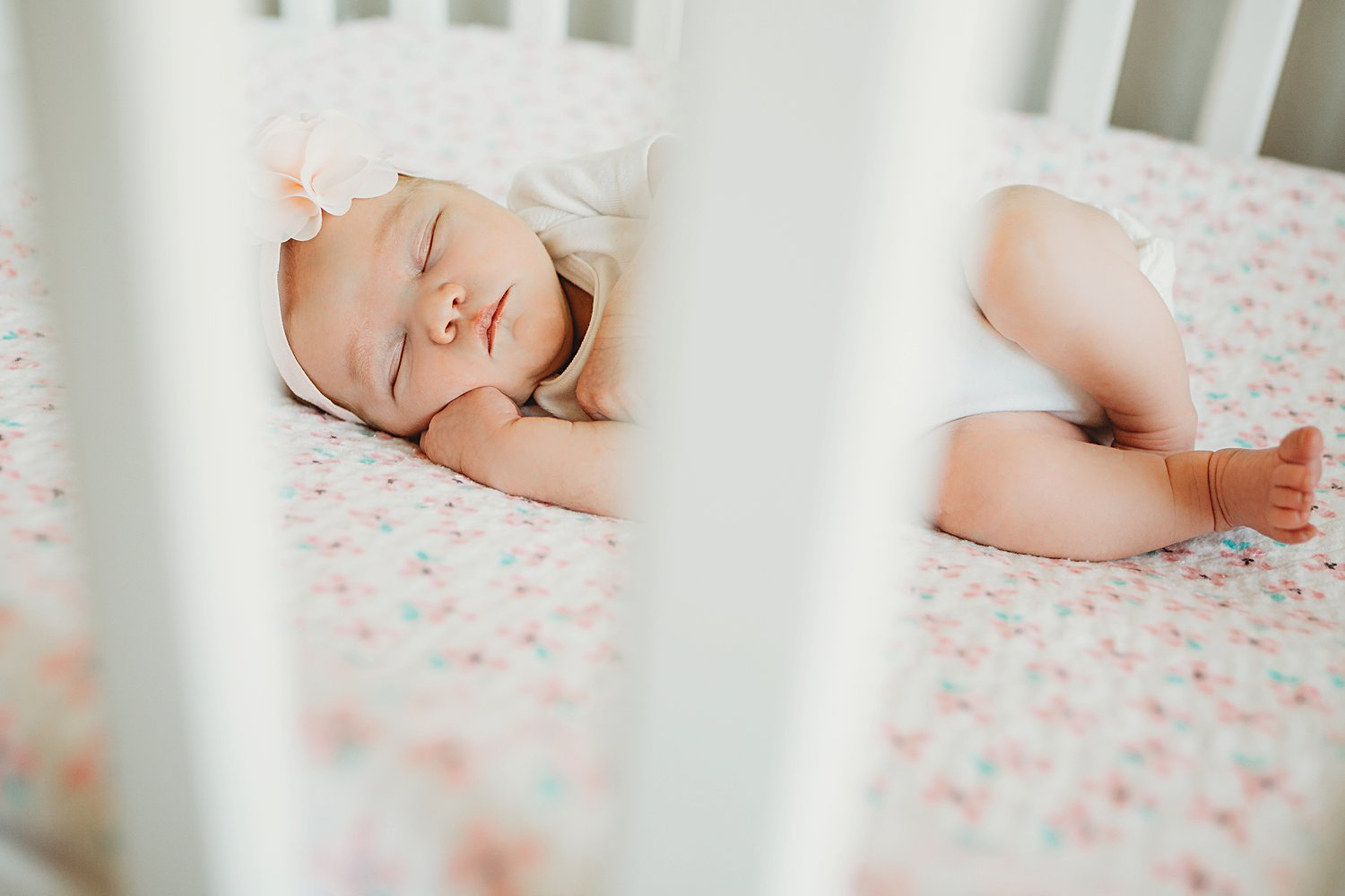 Newborn baby asleep in crib