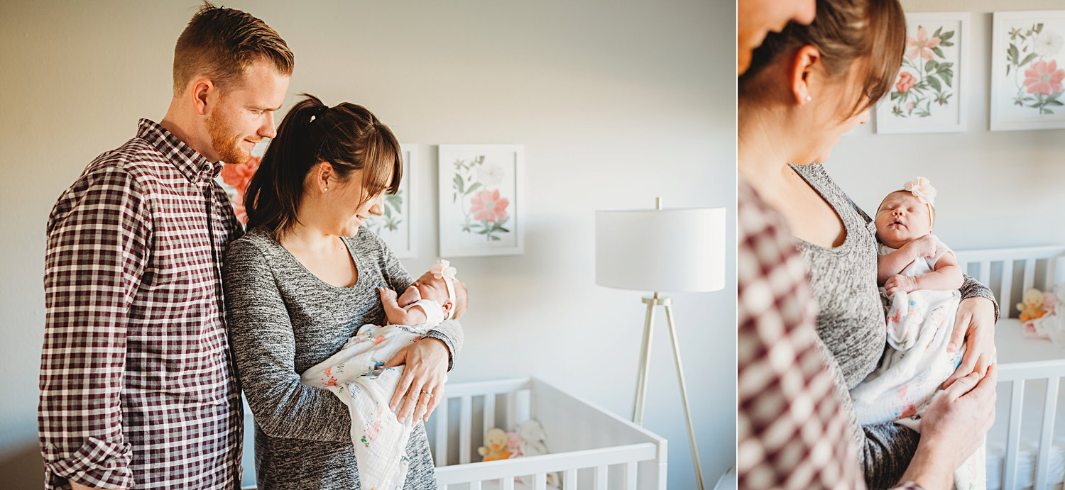 Lifestyle newborn photos of mom and dad holding baby in nursery