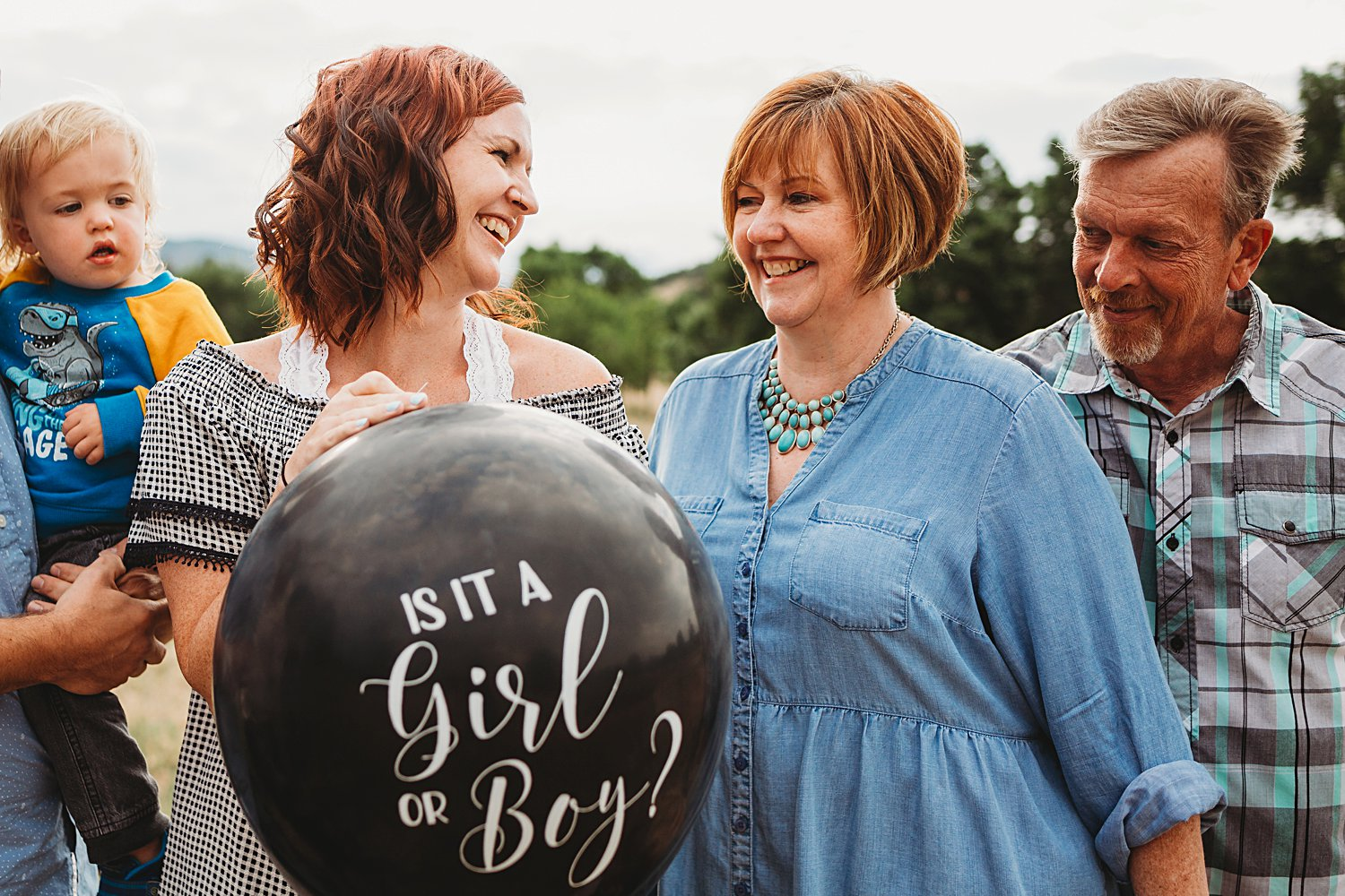 Mom and daughter with gender reveal balloon
