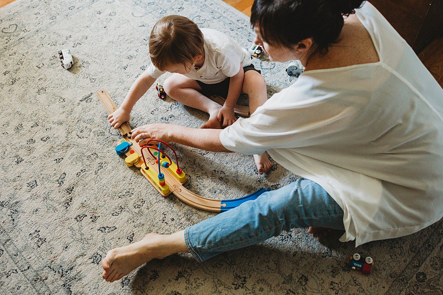 Mom and boy playing with toy