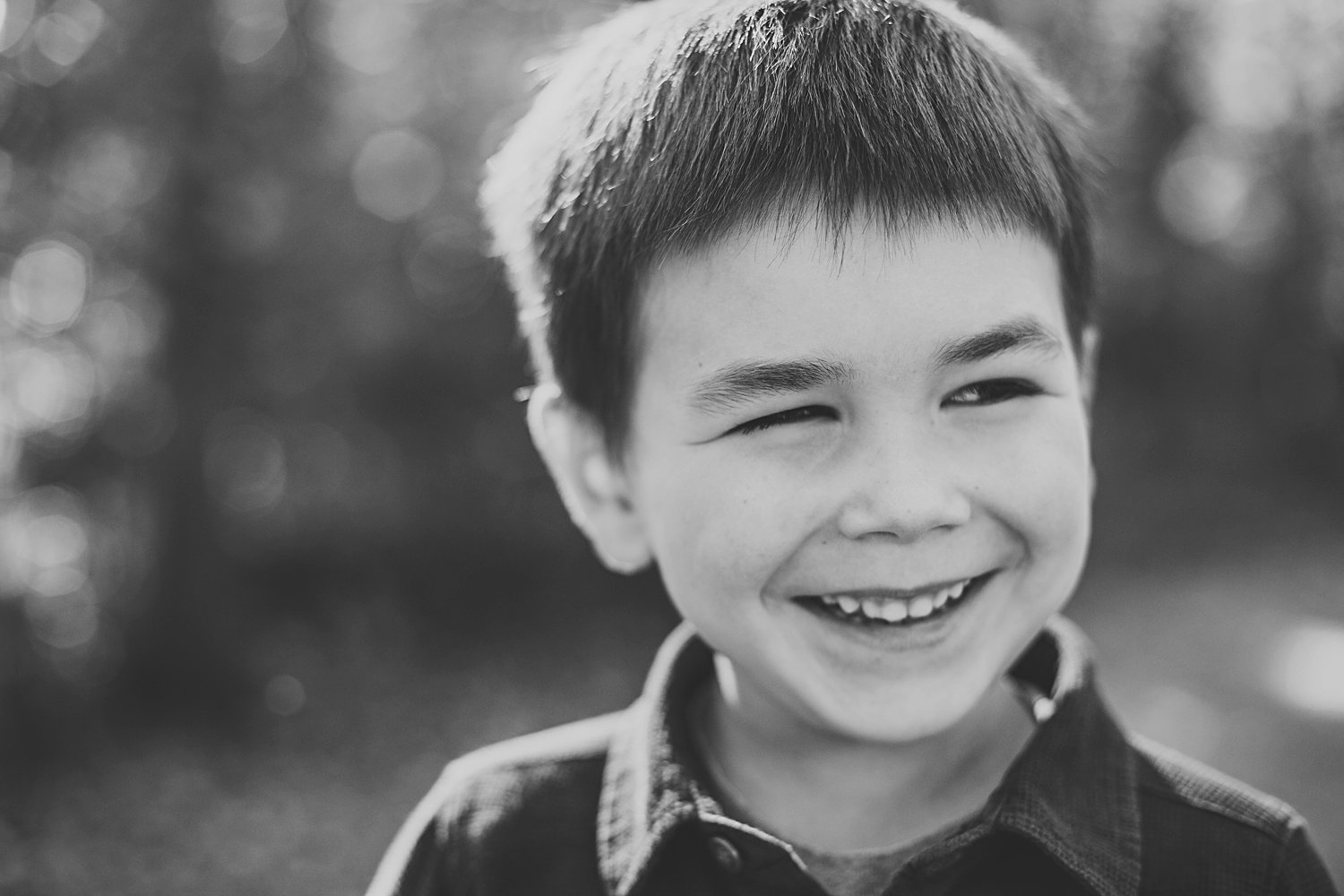 A young boy laughing