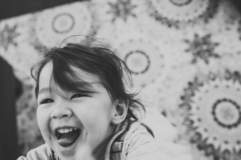 Toddler girl laughing and dancing around